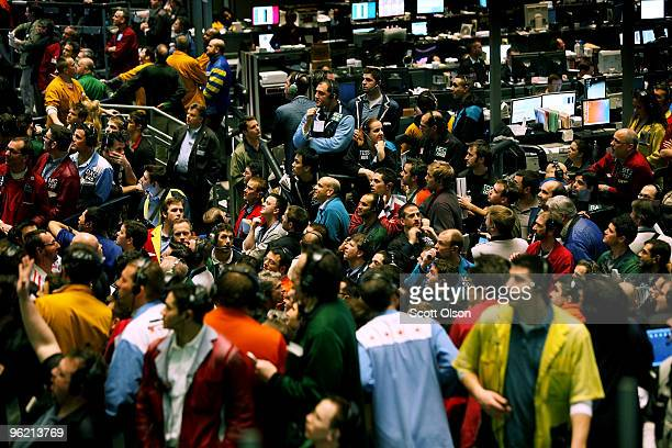 Traders in the Eurodollar pit on the CME Group trading floor watch the news boards for a statement following the Federal Open Market Committee...