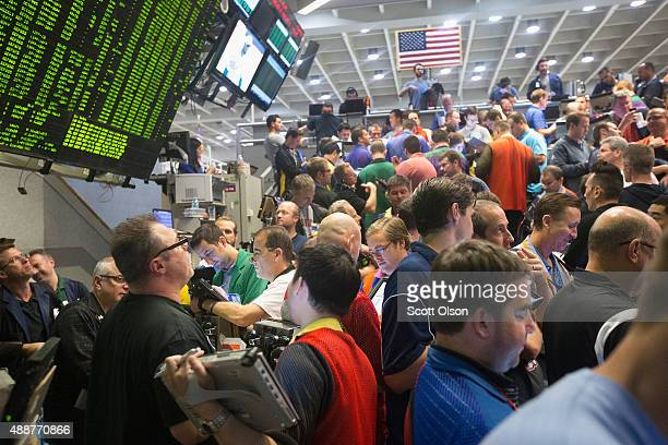 Traders in the Standard Poor's 500 stock index options pit at the Chicago Board Options Exchange wait for the Federal Reserve's decision on interest...