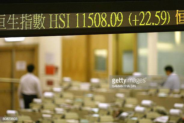 Traders leave early at the Hong Stock Stock Exchange 11 May 2004 as the Hang Seng Index recovers from earlier losses to end the day up by 2259 points...