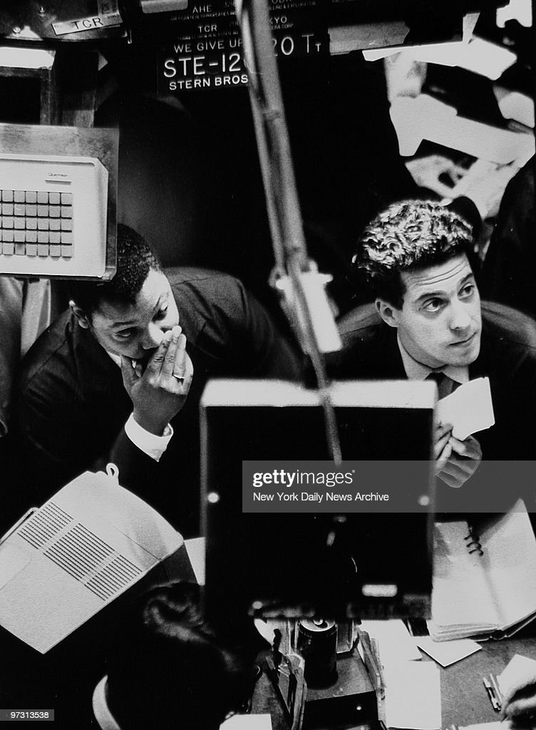 Traders look at numbers on screen on Black Monday at the Stock Exchange, Manhattan.