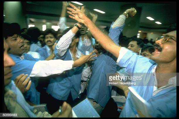 Traders making hand signals on frantic floor of Bombay Stock Exchange India's most active exchange w overseas investment pouring into market