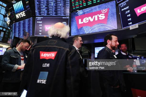 Traders many in jeans work on the floor of the New York Stock Exchange on the day that Levi Strauss has returned to the stock market with an IPO on...