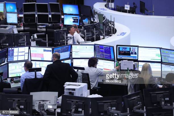 Traders monitor data inside the Frankfurt Stock Exchange in Frankfurt Germany on Monday April 24 2017 Frances bonds jumped with the 10year yield...