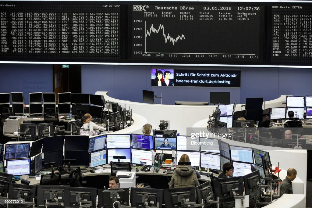 Traders monitor financial data as the second iteration of the Markets in Financial Instruments Directive (MiFID II) comes into force, at the Frankfurt Stock Exchange, operated by Deutsche Boerse AG, in Frankfurt, Germany, on Wednesday, Jan. 3, 2018. After seven years of preparation, $2 billion in compliance costs and one false start, the biggest shake-up to European regulation in a decade is finally here. Photographer: Alex Kraus/Bloomberg via Getty Images