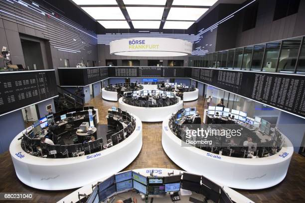 Traders monitor financial data following the the election of Emmanuel Macron as France's new president inside the Frankfurt Stock Exchange in...