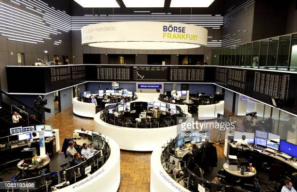 Traders monitor financial data inside inside the Frankfurt Stock Exchange, operated by Deutsche Boerse AG, in Frankfurt, Germany, on Wednesday, Jan....