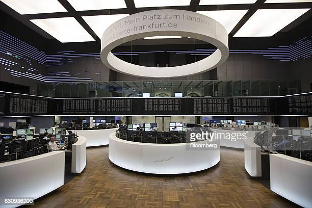 Traders monitor financial data inside the Frankfurt Stock Exchange in Frankfurt Germany on Wednesday Jan 4 2017 US unilateralism under Donald Trump...