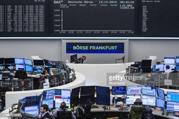 Traders monitor financial data inside the Frankfurt Stock Exchange, operated by Deutsche Boerse AG, in Frankfurt, Germany, on Friday, Dec. 13, 2019....