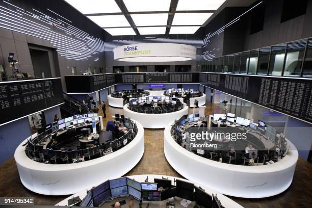 Traders monitor financial data inside the Frankfurt Stock Exchange operated by Deutsche Boerse AG in Frankfurt Germany on Tuesday Feb 6 2018 The...