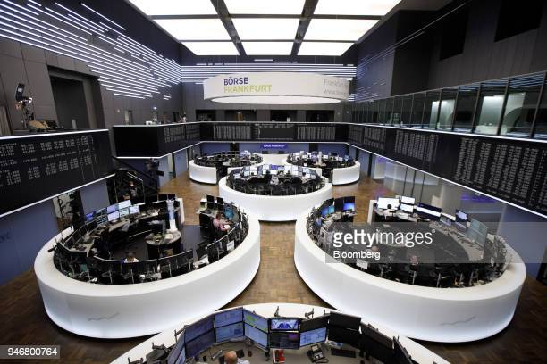 Traders monitor financial data inside the Frankfurt Stock Exchange operated by Deutsche Boerse AG in Frankfurt Germany on Monday April 16 2018 Bonds...