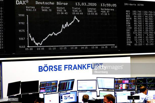 Traders monitor financial data on the trading floor near the DAX Index curve inside the Frankfurt Stock Exchange, operated by Deutsche Boerse AG, in...