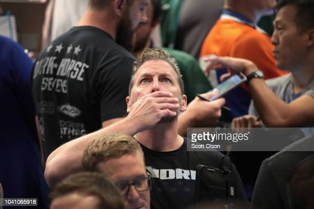 Traders monitor offers in the SP options pit at the Cboe Global Markets exchange shortly after the Federal Reserve announced it was raising interest...