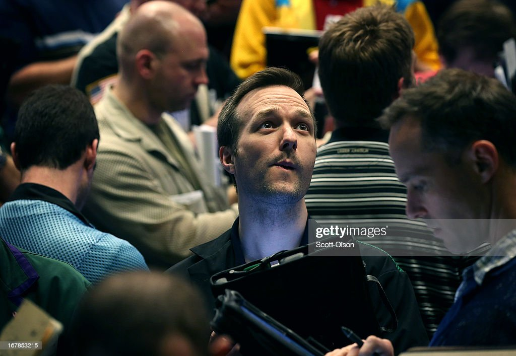 Traders monitor prices in the Standard & Poor's 500 stock index options pit at the Chicago Board Options Exchange (CBOE) prior to remarks from the Federal Reserve following the Feds two-day meeting of its policy-making committee on May 1, 2013 in Chicago, Illinois. Stating the economy was expanding at a 'moderate pace' and that the labor market had shown 'some improvement' the Federal Reserve said today that it would continue its stimulus campaign at the same pace it has maintained since December.
