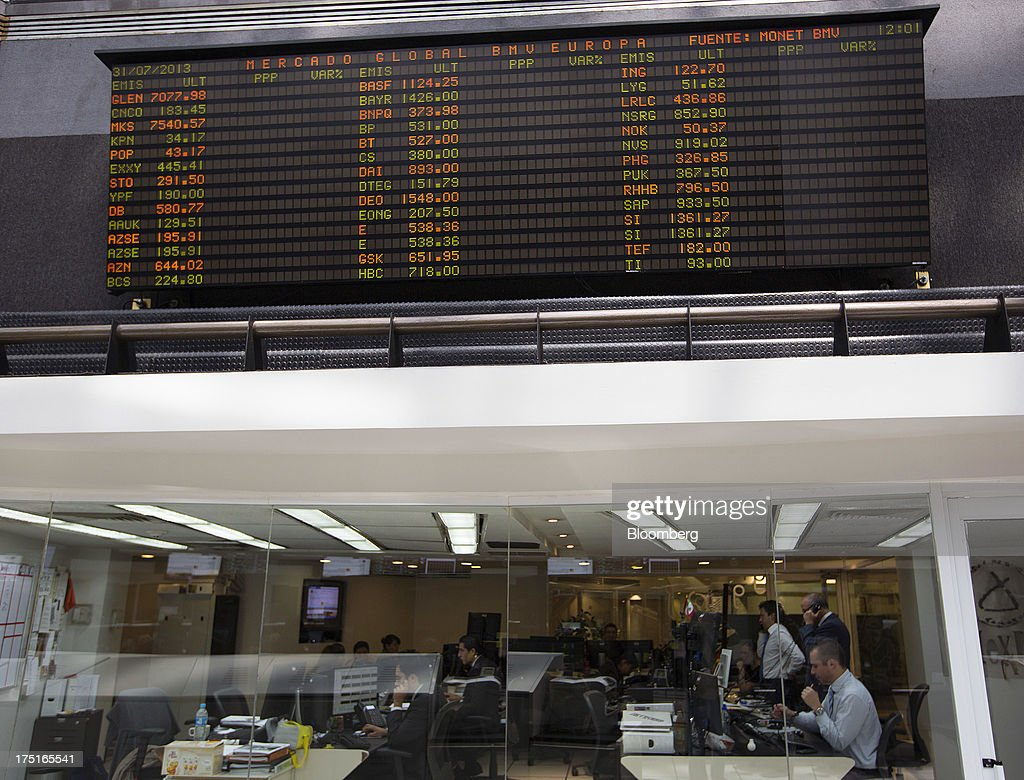 Traders monitor the markets on the trading gallery of Bolsa Mexicana de Valores (BMV), Mexico's stock exchange, in Mexico City, Mexico, on Wednesday, July 31, 2013. Mexico's economy is forecast to grow 2.8 percent this year based on analyst estimates compiled by Bloomberg. Photographer: Susana Gonzalez/Bloomberg via Getty Images