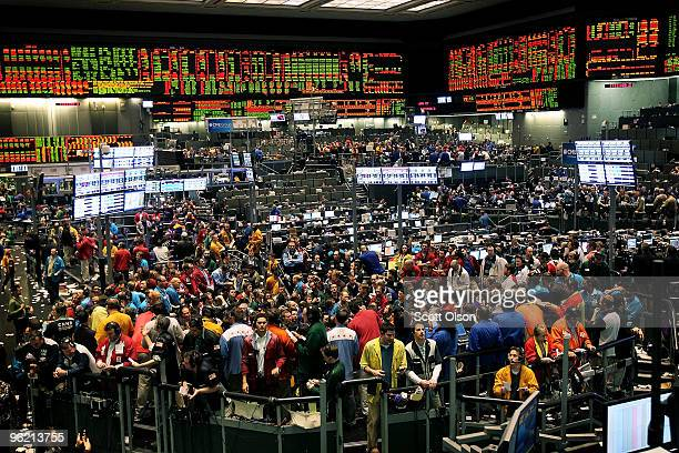 Traders on the CME Group trading floor wait for a statement following the Federal Open Market Committee meeting concerning short-term interest rates...