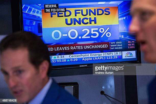 A traders on the floor of the New York Stock Exchange react to news that the Federal Reserve decided to not raise interest rates on September 17 2015...