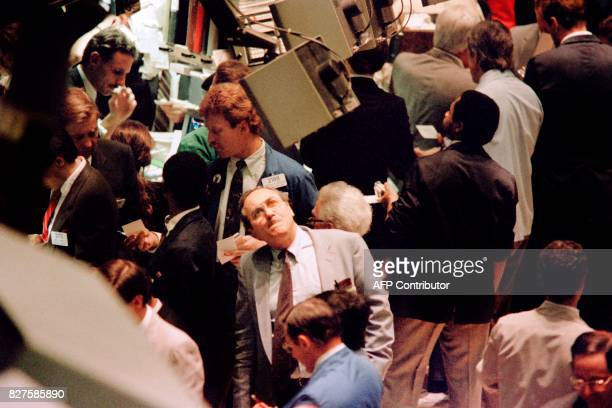 Traders on the New York Stock Exchange react on October 19 1987 as stocks are devastated during one of the most frantic days in the exchange's...