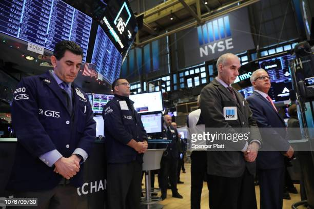 Traders pause for a moment of silence on the floor of the New York Stock Exchange in remembrance of former President George H.W. Bush on December 03,...