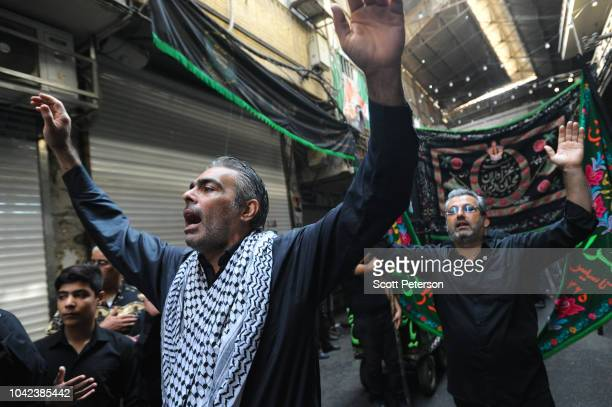 Traders pound their chests in a ritual in the Bazaar as Iranians mark the anniversary of the 7thcentury death of the third Shiite Imam Hossein with...