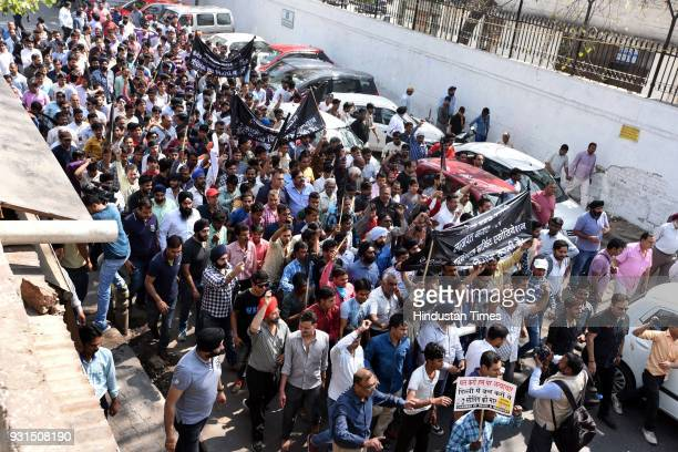 Traders protest against sealing drive at MCD office in Kashmere Gate on March 13 2018 in New Delhi India The ongoing sealing drive in Delhi has sent...