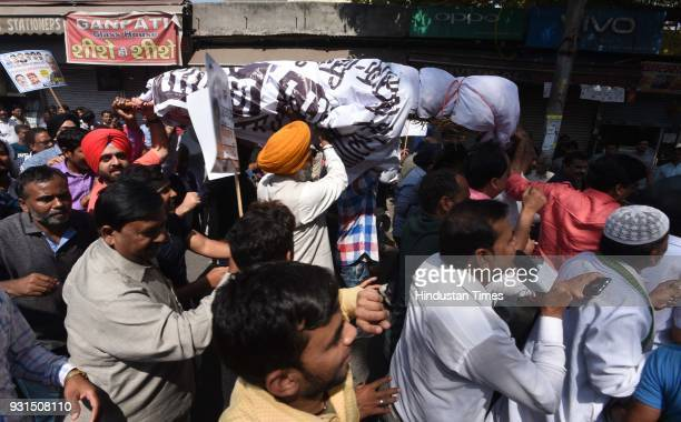 Traders protesting against sealing drive at MCD office in Kashmere Gate on March 13 2018 in New Delhi India The ongoing sealing drive in Delhi has...
