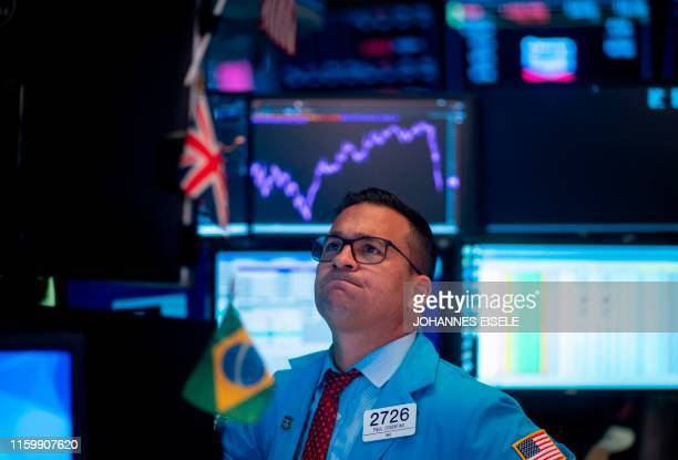 Traders react after the closing bell at the New York Stock Exchange on August 5 2019 at Wall Street in New York City Wall Street stocks plunged after...