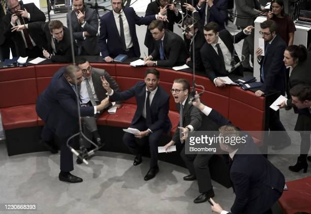 Traders react on the trading floor of the open outcry pit at the London Metal Exchange Ltd. At Finsbury Square in London, U.K., on Monday, April 10,...