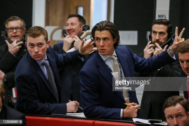 Traders react on the trading floor of the open outcry pit at the London Metal Exchange Ltd. At Finsbury Square in London, U.K., on Thursday, Jan. 11,...