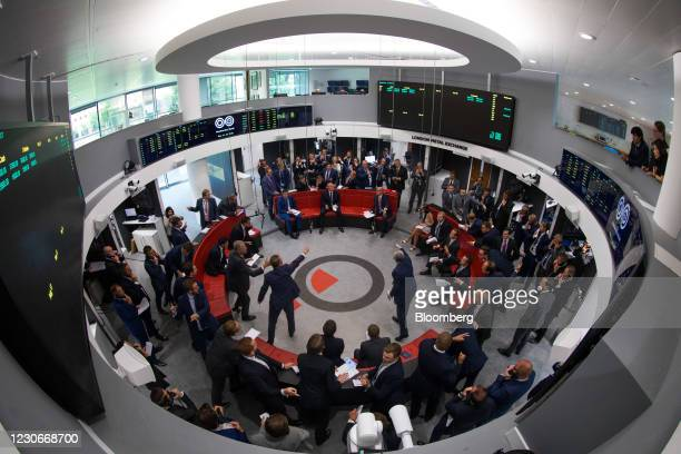 Traders react on the trading floor of the open outcry pit at the London Metal Exchange Ltd. At Finsbury Square in London, U.K., on Monday, July 31,...