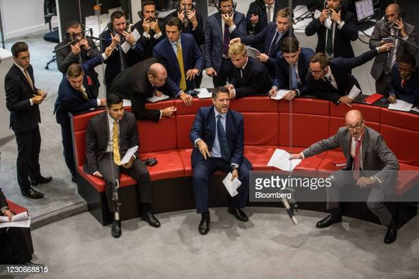 Traders react on the trading floor of the open outcry pit at the London Metal Exchange Ltd. At Finsbury Square in London, U.K., on Wednesday, Aug....