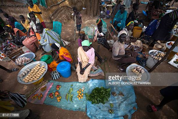 Traders sell vegetables in an empty stocked market in Akuem outside Aweil on October 12 2016 More than 50% of the cultivation has been lost in the...