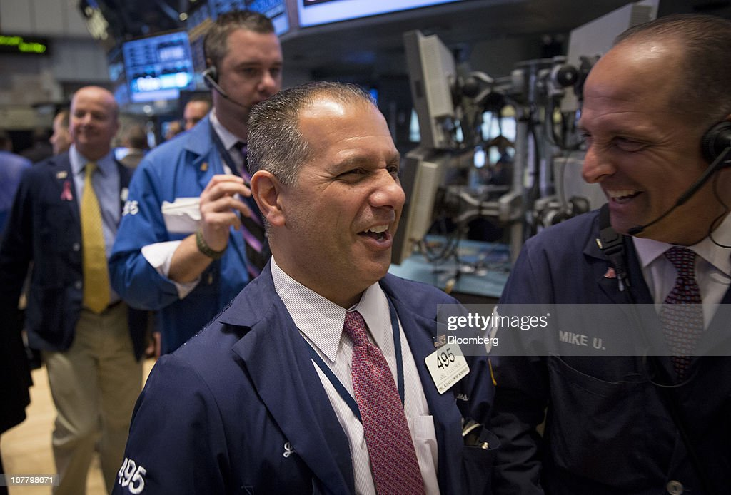 Traders share a laugh at the New York Stock Exchange (NYSE) in New York, U.S., on Tuesday, April 30, 2013. U.S. stocks fell as business activity unexpectedly shrank in April for the first time in more than three years, offsetting a rise in confidence among American consumers. Photographer: Scott Eells/Bloomberg via Getty Images
