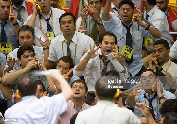 Traders signal at the Brazilian Bolsa de Mercadorias e Futuros or Brazilian Mercantile and Futures Exchange in Sao Paulo Brazil on Wednesday Feb 20...