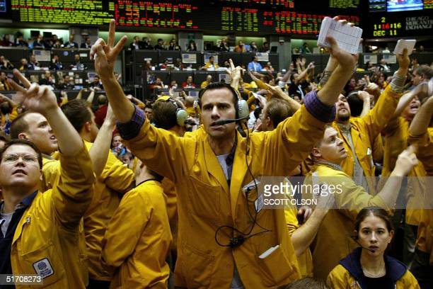 Traders signal bids and offers in the Eurodollar pit at the Chicago Mercantile Exchange following the Federal Open Market Committee announcement of a...