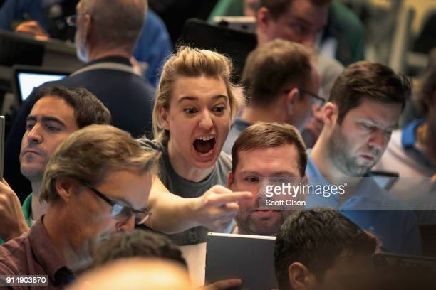 Traders signal offers in the SP options pit at the Cboe Global Markets Inc exchange on February 6 2018 in Chicago Illinois Yesterday the SP 500 and...
