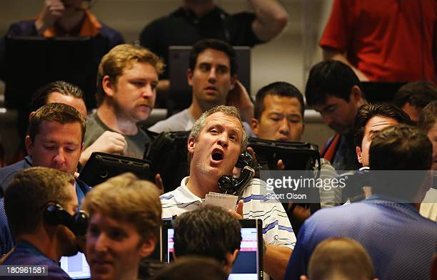 Traders signal offers in the Standard & Poor's 500 stock index options pit at the Chicago Board Options Exchange following the Federal Open Market...