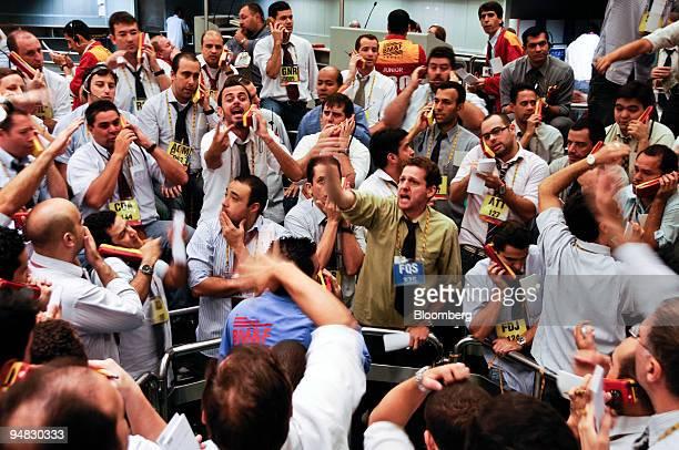 Traders signal orders at the Brazilian Bolsa de Mercadorias e Futuros or Brazilian Mercantile and Futures Exchange in Sao Paulo Brazil on Friday May...