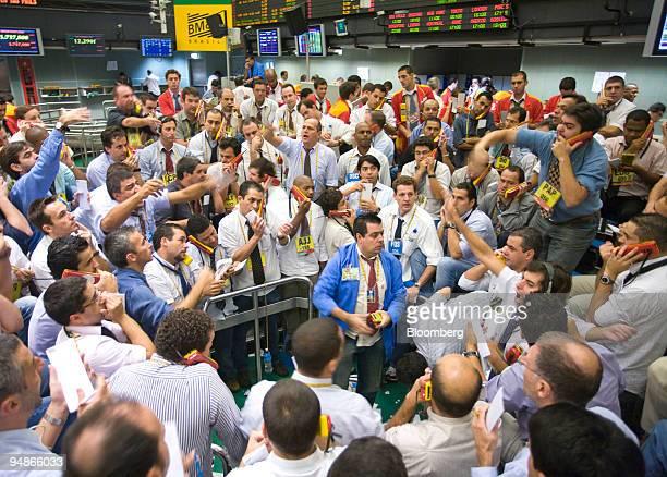 Traders signal orders at the Brazilian Bolsa de Mercadorias e Futuros or Brazilian Mercantile and Futures Exchange in Sao Paulo Brazil on Friday...
