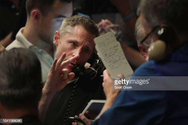 A traders signals an offer in the SP options pit at the Cboe Global Markets exchange shortly after the Federal Reserve announced it was raising...