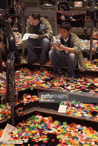 Traders sit in a confetti littered Eurodollar options pit at the CME Group after the close of the final trading session of the year December 31 2010...