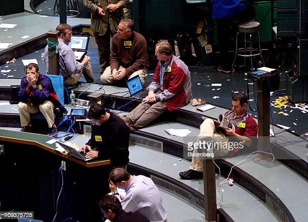Traders sit in the crude oil futures pit at the New York Mercantile Exchange in New York US on Wednesday Feb 23 2011 Oil surged to $100 a barrel in...