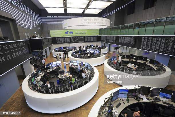Traders sit in trading floor desk pods near the DAX Index curve inside the Frankfurt Stock Exchange, operated by Deutsche Boerse AG, in Frankfurt,...
