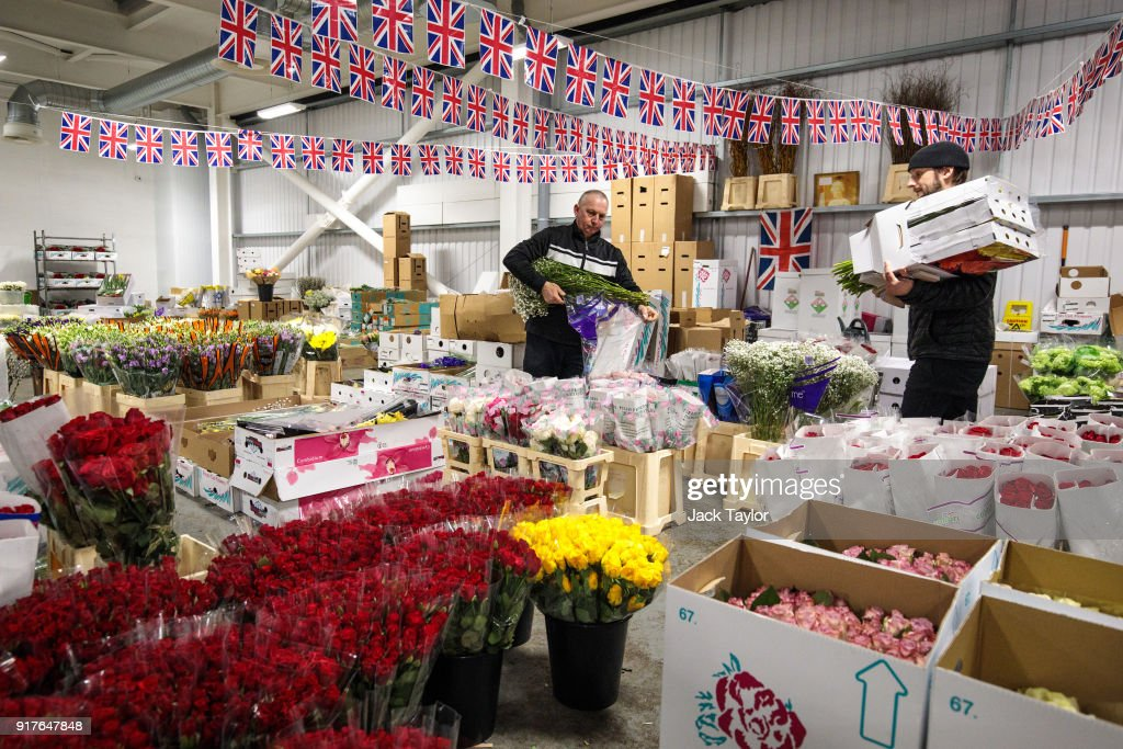 Traders sort through flowers under Union Jack bunting at New Covent Garden Flower Market ahead of Valentine's Day on February 13, 2018 in London, England. New Covent Garden market is the largest wholesale fruit, vegetable, and flower market in the United Kingdom, supplying 75% of florists in London.