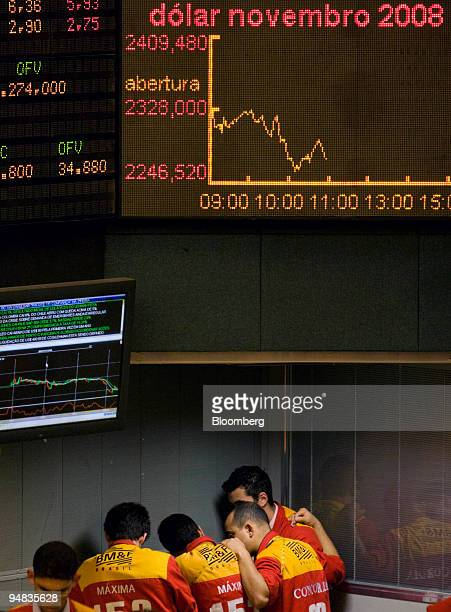 Traders speak in a corner at the Bolsa de Mercadorias e Futuros or Brazilian Mercantile and Futures Exchange in Sao Paulo Brazil on Friday Oct 2008...