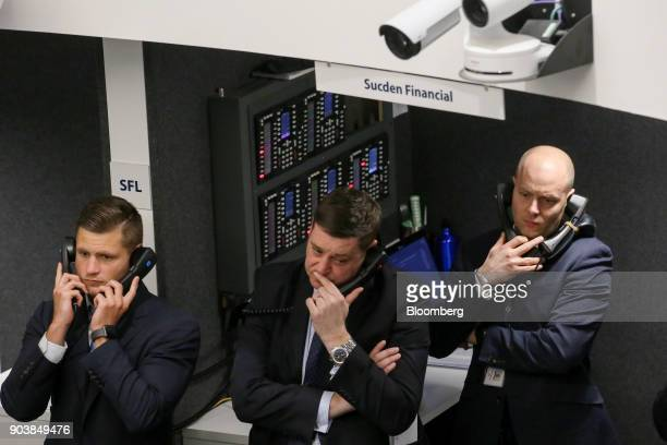 Traders speak on fixed line telephones on the trading floor of the open outcry pit at the London Metal Exchange Ltd in London UK on Thursday Jan 11...