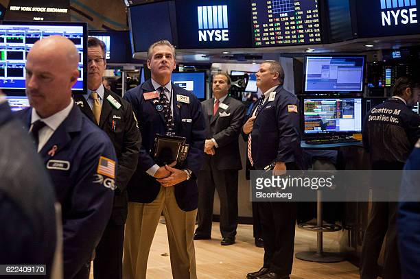 Traders take a moment of silence in honor of Veteran's Day on the floor of the New York Stock Exchange in New York US on Friday Nov 11 2016 US stocks...
