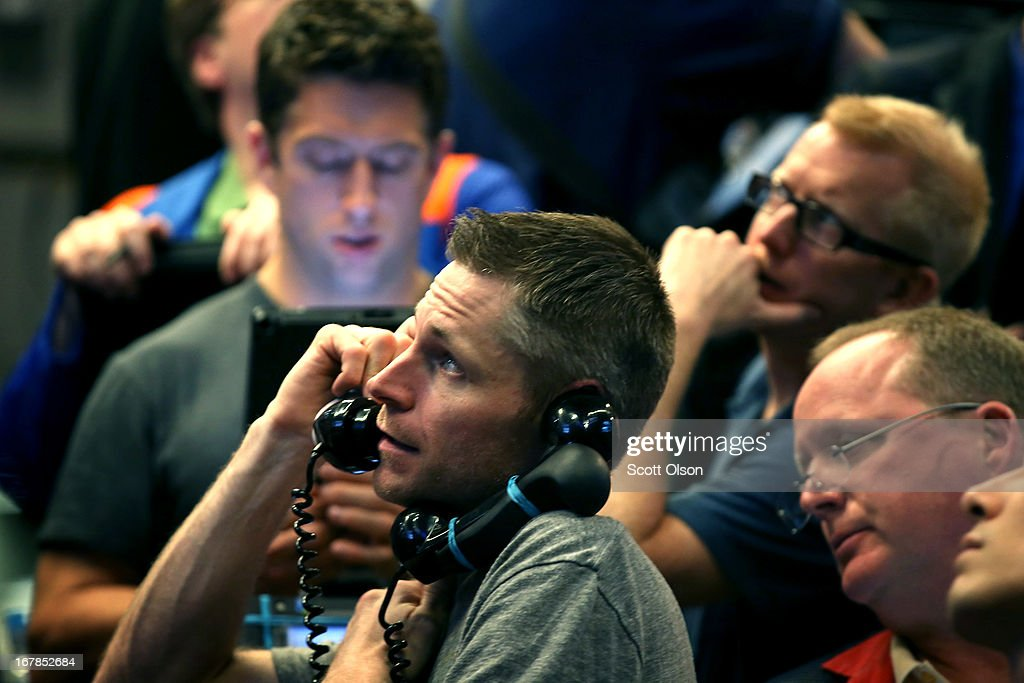 Traders take orders in the Standard & Poor's 500 stock index options pit at the Chicago Board Options Exchange (CBOE) prior to remarks from the Federal Reserve following the Feds two-day meeting of its policy-making committee on May 1, 2013 in Chicago, Illinois. Stating the economy was expanding at a 'moderate pace' and that the labor market had shown 'some improvement' the Federal Reserve said today that it would continue its stimulus campaign at the same pace it has maintained since December.