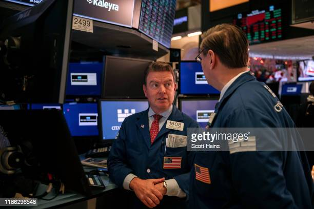 Traders talk after the market's closing bell on the floor of the New York Stock Exchange on December 3, 2019 in New York City. The Dow Jones...
