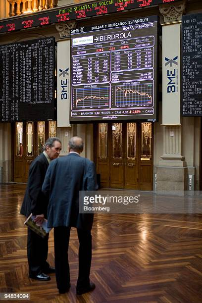 Traders talk at the Bolsas y Mercados stock exchange in Madrid Spain on Friday Oct 10 2008 European stocks tumbled driving the Dow Jones Stoxx 600...