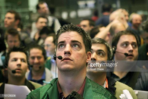 Traders watch prices in the Ten-Year Treasury Note options pit at the CME Group following the announcement by the Federal Open Market Committee that...
